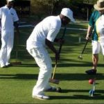 Moses Chivandire & Godfrey Masawi receiving coaching from Grahame Tomes & William Louw.